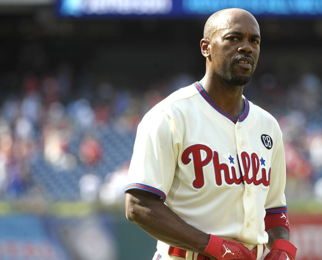 Jun 29, 2014; Philadelphia, PA, USA; Philadelphia Phillies shortstop Jimmy Rollins (11) reacts after final out in the ninth inning of loss to Atlanta Braves at Citizens Bank Park. The Braves won 3-2. Mandatory Credit: Eric Hartline-USA TODAY Sports