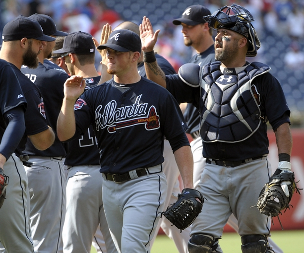 Jun 29, 2014; Philadelphia, PA, USA; Atlanta Braves relief pitcher Craig Kimbrel (46) and catcher Gerald Laird (11) celebrate with teammates after defeating the Philadelphia Phillies 3-2 at Citizens Bank Park. Mandatory Credit: Eric Hartline-USA TODAY Sports