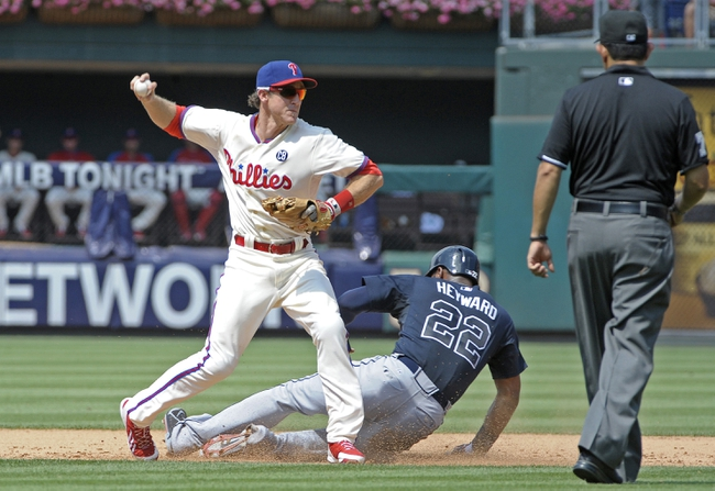 Jun 29, 2014; Philadelphia, PA, USA; Philadelphia Phillies second baseman Chase Utley (26) gets the force out on Atlanta Braves right fielder Jason Heyward (22) and throws to first base for double play in the fifth inning at Citizens Bank Park. The Braves won 3-2. Mandatory Credit: Eric Hartline-USA TODAY Sports