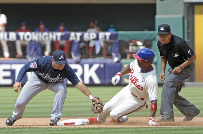 Jun 29, 2014; Philadelphia, PA, USA; Philadelphia Phillies shortstop Jimmy Rollins (11) slides safely into second base ahead of tag by Atlanta Braves second baseman Tommy La Stella (7) during the fifth inning at Citizens Bank Park. The Braves won 3-2. Mandatory Credit: Eric Hartline-USA TODAY Sports