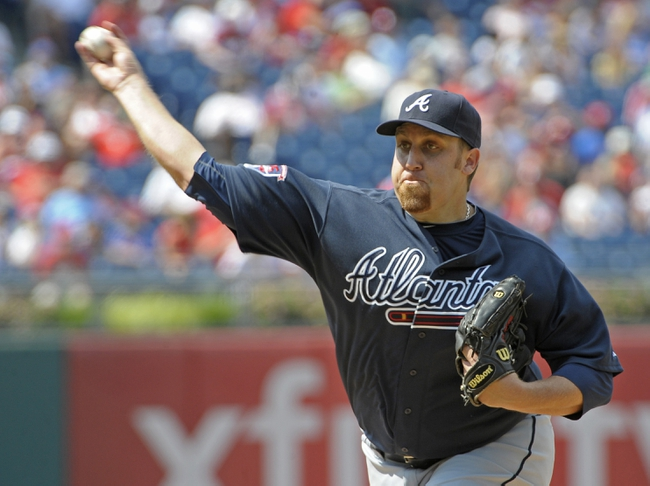 Jun 29, 2014; Philadelphia, PA, USA; Atlanta Braves starting pitcher Aaron Harang (34) throws a pitch during the sixth inning against the Philadelphia Phillies at Citizens Bank Park. The Braves won 3-2. Mandatory Credit: Eric Hartline-USA TODAY Sports