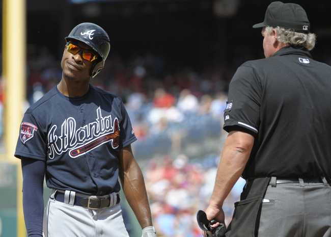 Jun 29, 2014; Philadelphia, PA, USA; Atlanta Braves center fielder B.J. Upton (2) reacts with umpire Ted Barrett (65) after striking out  against the Philadelphia Phillies  during the sixth inning at Citizens Bank Park. The Braves won 3-2. Mandatory Credit: Eric Hartline-USA TODAY Sports