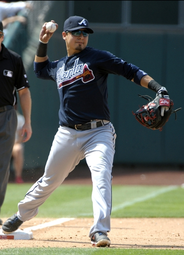Jun 29, 2014; Philadelphia, PA, USA; Atlanta Braves second baseman Ramiro Pena (14) steps on third base and throws to first base for double play during the sixth inning against the Philadelphia Phillies at Citizens Bank Park. The Braves won 3-2. Mandatory Credit: Eric Hartline-USA TODAY Sports