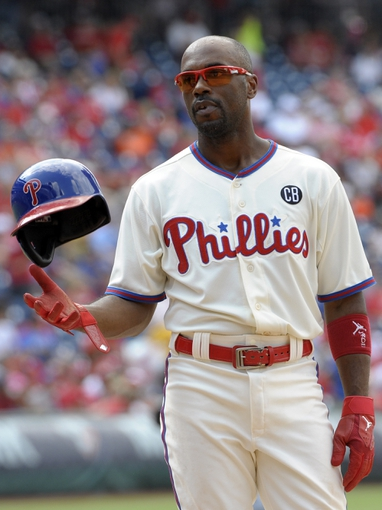 Jun 29, 2014; Philadelphia, PA, USA; Philadelphia Phillies shortstop Jimmy Rollins (11) reacts after Ryan Howard (not pictured) grounded into a double play to end the seventh inning against the Atlanta Braves at Citizens Bank Park. The Braves won 3-2. Mandatory Credit: Eric Hartline-USA TODAY Sports