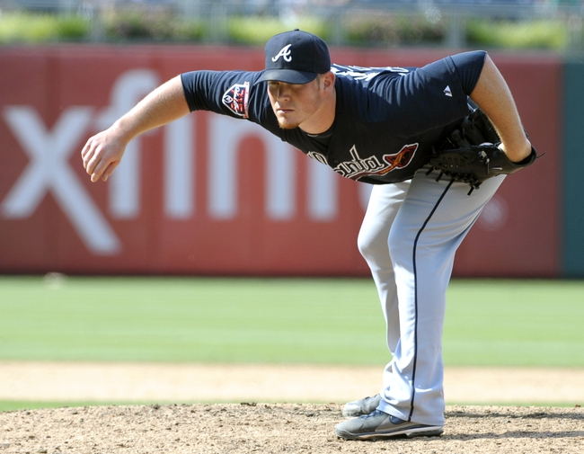 Jun 29, 2014; Philadelphia, PA, USA; Atlanta Braves relief pitcher Craig Kimbrel (46) looks for a signal from the catcher during ninth inning against the Philadelphia Phillies at Citizens Bank Park. The Braves won 3-2. Mandatory Credit: Eric Hartline-USA TODAY Sports