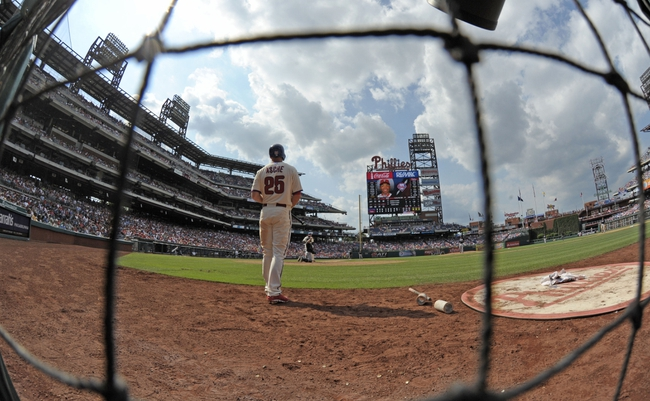 Jun 29, 2014; Philadelphia, PA, USA; Philadelphia Phillies third baseman Cody Asche (25) waits on deck during game against the Atlanta Braves at Citizens Bank Park. The Braves won 3-2. Mandatory Credit: Eric Hartline-USA TODAY Sports