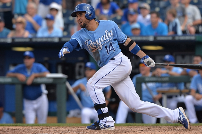 Jun 29, 2014; Kansas City, MO, USA; Kansas City Royals second basemen Omar Infante (14) hits a walk off single for a 5-4 win against the Los Angeles Angels during the ninth inning at Kauffman Stadium. Mandatory Credit: Peter G. Aiken-USA TODAY Sports
