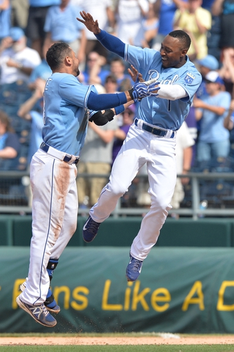 Jun 29, 2014; Kansas City, MO, USA; Kansas City Royals second basemen Omar Infante (14) celebrates with teammate Jarrod Dyson (1) after hitting a walk off single for a 5-4 win against the Los Angeles Angels at Kauffman Stadium. Mandatory Credit: Peter G. Aiken-USA TODAY Sports