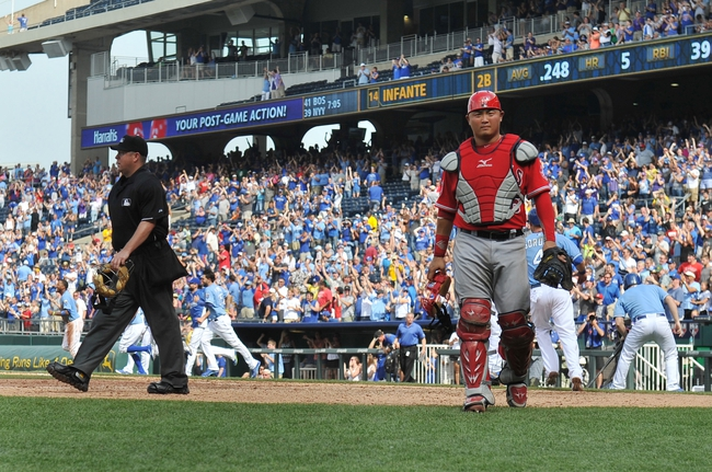 Jun 29, 2014; Kansas City, MO, USA; Los Angeles Angels catcher Hank Conger (16) walks off the field after Kansas City Royals Omar Infante's (not pictured) walk off single in the first inning at Kauffman Stadium. Mandatory Credit: Peter G. Aiken-USA TODAY Sports