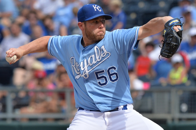 Jun 29, 2014; Kansas City, MO, USA; Kansas City Royals pitcher Greg Holland (56) delivers a pitch against the Los Angeles Angels during the ninth inning at Kauffman Stadium. Mandatory Credit: Peter G. Aiken-USA TODAY Sports