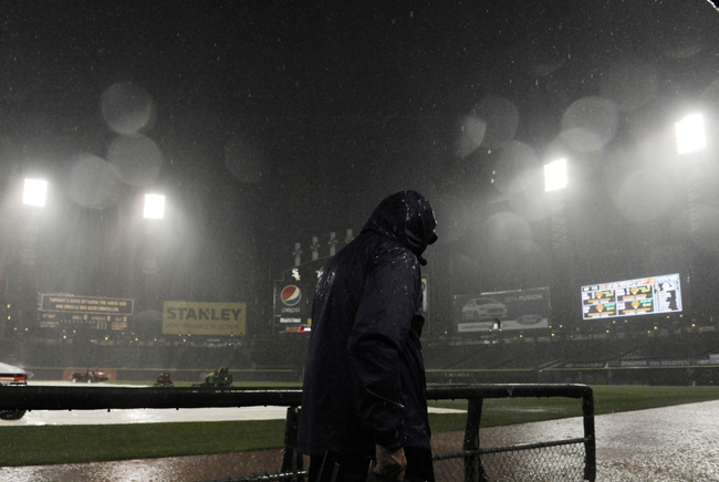 Jun 30, 2014; Chicago, IL, USA;  A worker leaves the field area after the game between the Chicago White Sox and the Los Angeles Angels was cancelled due to severe weather at U.S Cellular Field. Mandatory Credit: David Banks-USA TODAY Sports
