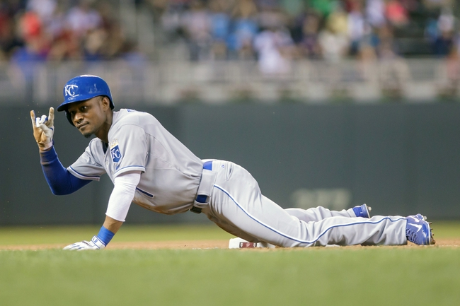 Jun 30, 2014; Minneapolis, MN, USA; Kansas City Royals center fielder Jarrod Dyson (1) salutes his dugout after a triple in the seventh inning against the Minnesota Twins at Target Field. The Kansas City Royals win 6-1. Mandatory Credit: Brad Rempel-USA TODAY Sports