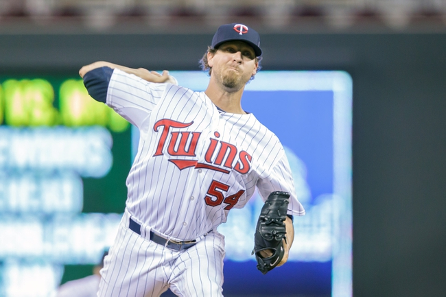 Jun 30, 2014; Minneapolis, MN, USA; Minnesota Twins relief pitcher Matt Guerrier (54) pitches in the seventh inning against the Kansas City Royals at Target Field. The Kansas City Royals win 6-1. Mandatory Credit: Brad Rempel-USA TODAY Sports