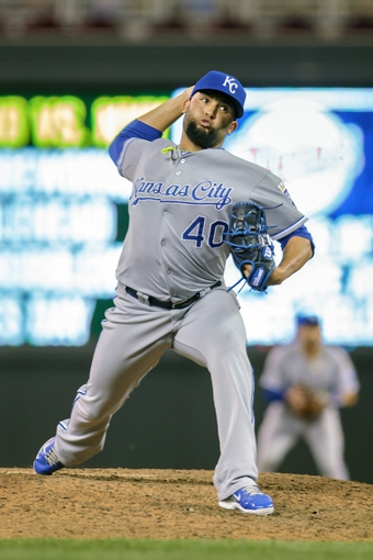 Jun 30, 2014; Minneapolis, MN, USA; Kansas City Royals relief pitcher Kelvin Herrera (40) pitches in the seventh inning against the Minnesota Twins at Target Field. The Kansas City Royals win 6-1. Mandatory Credit: Brad Rempel-USA TODAY Sports