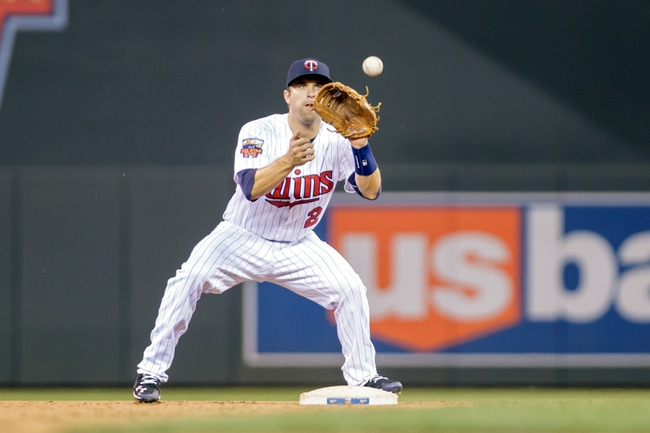 Jun 30, 2014; Minneapolis, MN, USA; Minnesota Twins second baseman Brian Dozier (2) makes the out at second in the eighth inning against the Kansas City Royals at Target Field. The Kansas City Royals win 6-1. Mandatory Credit: Brad Rempel-USA TODAY Sports