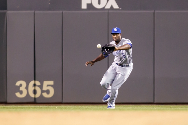 Jun 30, 2014; Minneapolis, MN, USA; Kansas City Royals right fielder Lorenzo Cain (6) fields a ball in the eighth inning against the Minnesota Twins at Target Field. The Kansas City Royals win 6-1. Mandatory Credit: Brad Rempel-USA TODAY Sports