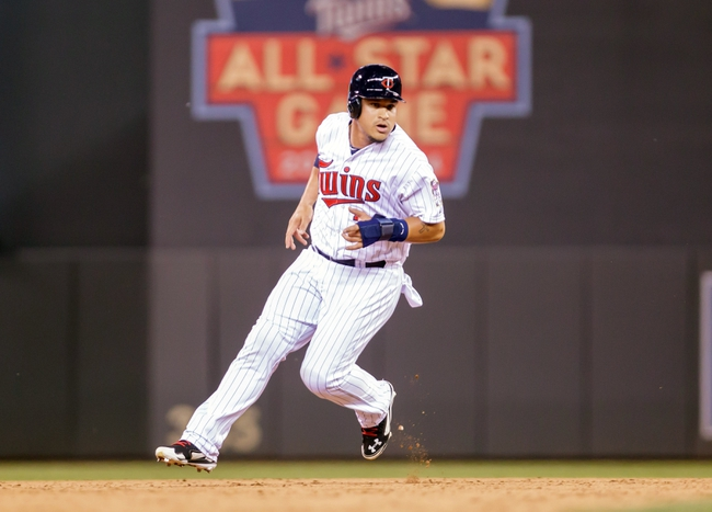 Jun 30, 2014; Minneapolis, MN, USA; Minnesota Twins right fielder Oswaldo Arcia (31) rounds second in the ninth inning against the Kansas City Royals at Target Field. The Kansas City Royals win 6-1. Mandatory Credit: Brad Rempel-USA TODAY Sports