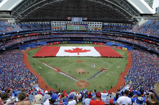 Jul 1, 2014; Toronto, Ontario, CAN; A general view as a Canadian flag is unfurled across the outfield for Canada Day before the game between the Milwaukee Brewers and Toronto Blue Jays at Rogers Centre. Mandatory Credit: Peter Llewellyn-USA TODAY Sports