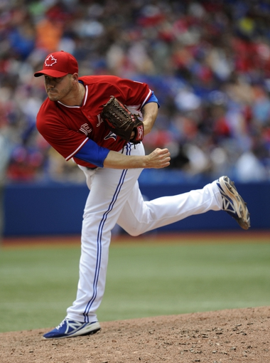 Jul 1, 2014; Toronto, Ontario, CAN; Blue Jays relief pitcher Dustin McGowan (29) throws against the Milwaukee Brewers during the 6th inning at Rogers Centre. Mandatory Credit: Peter Llewellyn-USA TODAY Sports