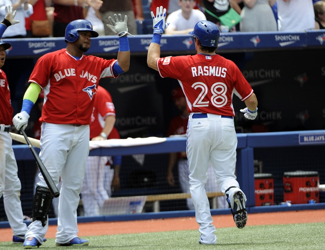 Jul 1, 2014; Toronto, Ontario, CAN; Toronto Blue Jays Colby Rasmus (28) celebrates his home run with teammate Juan Francisco (left) during the game against the Milwaukee Brewers at Rogers Centre. Mandatory Credit: Peter Llewellyn-USA TODAY Sports