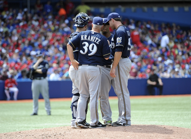 Jul 1, 2014; Toronto, Ontario, CAN; Milwaukee Brewers pitching coach Rick Kranitz (39) talks with catcher Jonathon Lucroy (20) and relief pitcher Zach Duke (59) during the game against the Toronto Blue Jays at Rogers Centre. Mandatory Credit: Peter Llewellyn-USA TODAY Sports