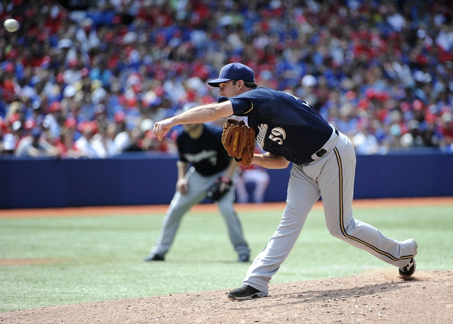 Jul 1, 2014; Toronto, Ontario, CAN; Milwaukee Brewers relief pitcher Zach Duke (59) throws against the Toronto Blue Jays at Rogers Centre. Mandatory Credit: Peter Llewellyn-USA TODAY Sports