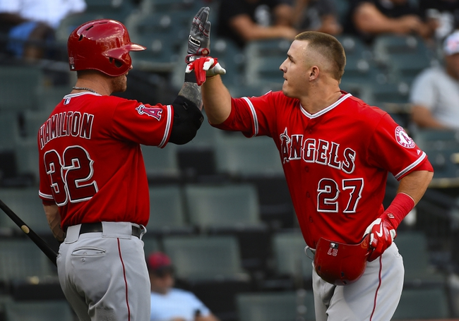 Jul 1, 2014; Chicago, IL, USA; Los Angeles Angels center fielder Mike Trout (27) reacts after hitting a three run home run against Chicago White Sox starting pitcher Hector Noesi (not pictured) during the fifth inning at U.S Cellular Field. Mandatory Credit: Mike DiNovo-USA TODAY Sports