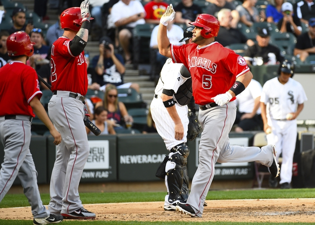 Jul 1, 2014; Chicago, IL, USA; Los Angeles Angels first baseman Albert Pujols (5) reacts after hitting a home run against Chicago White Sox starting pitcher Hector Noesi (not pictured) during the fifth inning at U.S Cellular Field. Mandatory Credit: Mike DiNovo-USA TODAY Sports