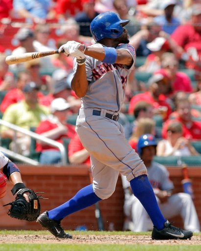 Jun 18, 2014; St. Louis, MO, USA; New York Mets left fielder Eric Young Jr. (22) hits a double during the seventh inning against the St. Louis Cardinals at Busch Stadium. The Mets won 3-2. Mandatory Credit: Scott Kane-USA TODAY Sports