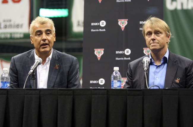 Jul 2, 2014; Milwaukee, WI, USA; Milwaukee Bucks co-owner Marc Lasry (left) as he speaks to the press as partner Wesley Edens listens during a news conference featuring new head coach Jason Kidd at the BMO Harris Bradley Center. Mandatory Credit: Mary Langenfeld-USA TODAY Sports