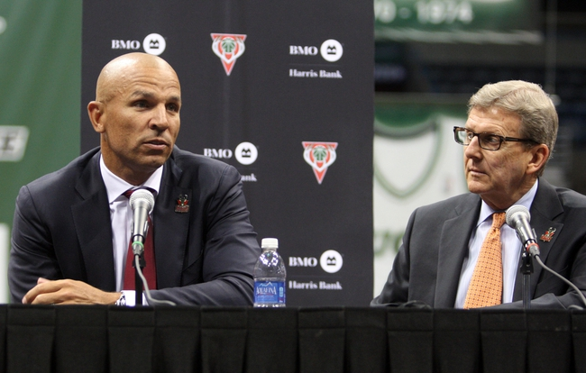 Jul 2, 2014; Milwaukee, WI, USA; Milwaukee Bucks new head coach Jason Kidd speaks to the press as general manager John Hammond listens during a news conference at the BMO Harris Bradley Center. Mandatory Credit: Mary Langenfeld-USA TODAY Sports