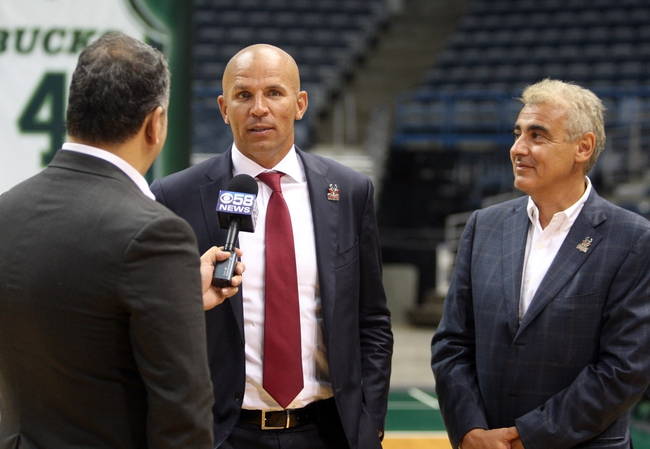 Jul 2, 2014; Milwaukee, WI, USA; Milwaukee Bucks new head coach Jason Kidd responds to a question as Bucks co-owner Marc Lasry listens during a post-news conference interview at the BMO Harris Bradley Center. Mandatory Credit: Mary Langenfeld-USA TODAY Sports
