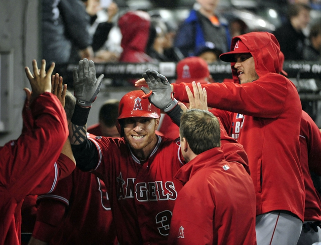 Jul 2, 2014; Chicago, IL, USA;  Los Angeles Angels left fielder Josh Hamilton (center) is greeted after hitting a home run against the Chicago White Sox during the eighth inning at U.S Cellular Field. The Chicago White Sox defeated the Los Angeles Angels 3-2. Mandatory Credit: David Banks-USA TODAY Sports