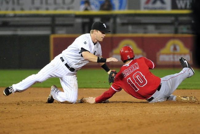 Jul 2, 2014; Chicago, IL, USA; Los Angeles Angels left fielder Grant Green (10) is tagged out by Chicago White Sox second baseman Gordon Beckham (15) during the ninth inning at U.S Cellular Field. The Chicago White Sox defeated the Los Angeles Angels 3-2. Mandatory Credit: David Banks-USA TODAY Sports