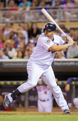 Jun 30, 2014; Minneapolis, MN, USA; Minnesota Twins designated hitter Kendrys Morales (17) at bat against the Kansas City Royals at Target Field. Mandatory Credit: Brad Rempel-USA TODAY Sports