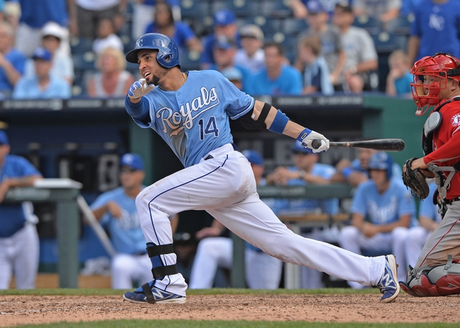 Jun 29, 2014; Kansas City, MO, USA; Kansas City Royals second basemen Omar Infante (14) drives in the winning run against the Los Angeles Angels during the ninth inning at Kauffman Stadium. Mandatory Credit: Peter G. Aiken-USA TODAY Sports
