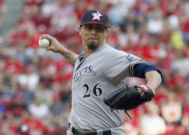 Jul 4, 2014; Cincinnati, OH, USA; Milwaukee Brewers starting pitcher Kyle Lohse throws against the Cincinnati Reds during the first inning at Great American Ball Park. Mandatory Credit: David Kohl-USA TODAY Sports