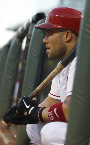 Jul 4, 2014; Cincinnati, OH, USA; Cincinnati Reds right fielder Skip Schumaker waits to bat during a game against the Milwaukee Brewers at Great American Ball Park. Mandatory Credit: David Kohl-USA TODAY Sports
