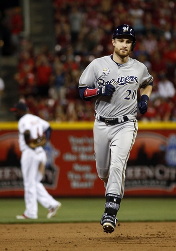 Jul 4, 2014; Cincinnati, OH, USA; Milwaukee Brewers catcher Jonathan Lucroy (20) rounds the bases after hitting a solo home run off Cincinnati Reds starting pitcher Alfredo Simon (not pictured) during the eighth inning at Great American Ball Park. The Reds won 4-2. Mandatory Credit: David Kohl-USA TODAY Sports