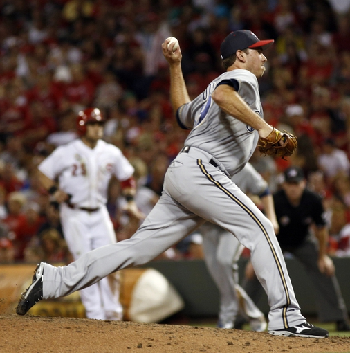 Jul 4, 2014; Cincinnati, OH, USA; Milwaukee Brewers relief pitcher Zach Duke throws against the Cincinnati Reds during the eighth inning at Great American Ball Park.The Reds won 4-2. Mandatory Credit: David Kohl-USA TODAY Sports