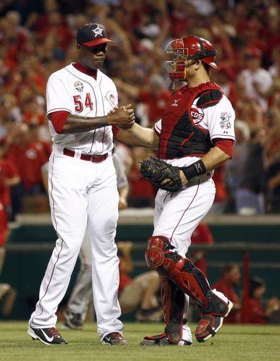 Jul 4, 2014; Cincinnati, OH, USA; Cincinnati Reds relief pitcher Aroldis Chapman (54) is congratulated by Cincinnati Reds catcher Devin Mesoraco, right, after the Reds defeated the Milwaukee Brewers 4-2 at Great American Ball Park. Mandatory Credit: David Kohl-USA TODAY Sports