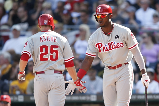 Jul 5, 2014; Pittsburgh, PA, USA; Philadelphia Phillies third baseman Cody Asche (25) is greeted at home plate by left fielder Domonic Brown (9) after Asche hit a solo home run against the Pittsburgh Pirates during the fourth inning at PNC Park. Mandatory Credit: Charles LeClaire-USA TODAY Sports