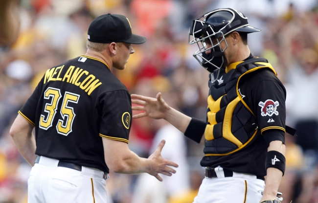 Jul 5, 2014; Pittsburgh, PA, USA; Pittsburgh Pirates relief pitcher Mark Melancon (35) and catcher Chris Stewart (R) shake hands after defeating the Philadelphia Phillies at PNC Park. The Pirates won 3-2. Mandatory Credit: Charles LeClaire-USA TODAY Sports