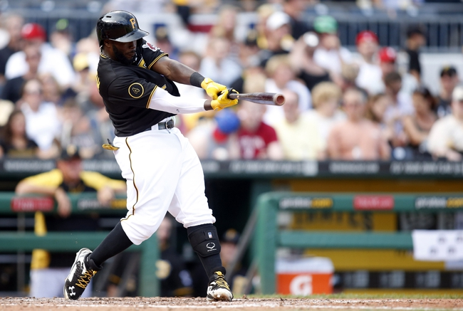 Jul 5, 2014; Pittsburgh, PA, USA; Pittsburgh Pirates second baseman Josh Harrison (5) singles against the Philadelphia Phillies during the sixth inning at PNC Park. The Pirates won 3-2. Mandatory Credit: Charles LeClaire-USA TODAY Sports