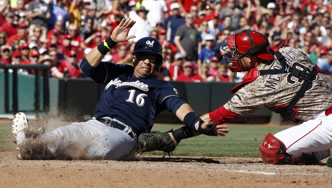 Jul 5, 2014; Cincinnati, OH, USA; Milwaukee Brewers third baseman Aramis Ramirez (16) is tagged out at home by Cincinnati Reds catcher Devin Mesoraco (39) during the sixth inning at Great American Ball Park. The Brewers won 1-0. Mandatory Credit: David Kohl-USA TODAY Sports