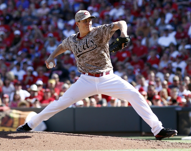 Jul 5, 2014; Cincinnati, OH, USA; Cincinnati Reds starting pitcher Homer Bailey throws against the Milwaukee Brewers during the fourth inning at Great American Ball Park. The Brewers won 1-0. Mandatory Credit: David Kohl-USA TODAY Sports