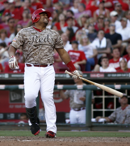 Jul 5, 2014; Cincinnati, OH, USA; Cincinnati Reds pinch hitter Brayan Pena reacts at bat in the eighth inning during a game against the Milwaukee Brewers at Great American Ball Park. The Brewers won 1-0. Mandatory Credit: David Kohl-USA TODAY Sports