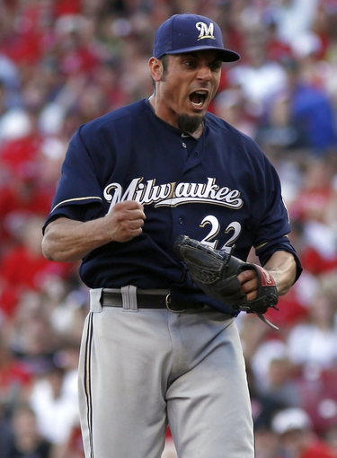 Jul 5, 2014; Cincinnati, OH, USA; Milwaukee Brewers starting pitcher Matt Garza reacts after pitching a complete game two-hit shutout against the Cincinnati Reds at Great American Ball Park. The Brewers won 1-0. Mandatory Credit: David Kohl-USA TODAY Sports