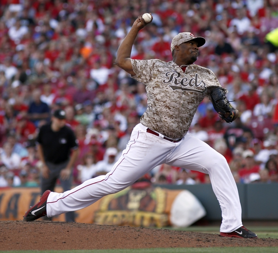 Jul 5, 2014; Cincinnati, OH, USA; Cincinnati Reds relief pitcher Jumbo Diaz throws against the Milwaukee Brewers during the ninth inning at Great American Ball Park. The Brewers won 1-0. Mandatory Credit: David Kohl-USA TODAY Sports