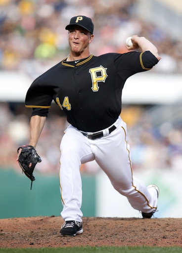 Jul 5, 2014; Pittsburgh, PA, USA; Pittsburgh Pirates relief pitcher Tony Watson (44) pitches against the Philadelphia Phillies during the eighth inning at PNC Park. The Pirates won 3-2. Mandatory Credit: Charles LeClaire-USA TODAY Sports